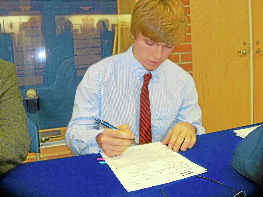 Peter Wallace — Register Citizen Housatonic's Willy Yahn signs his Letter of Intent to play UConn baseball next season. Photo: Journal Register Co.