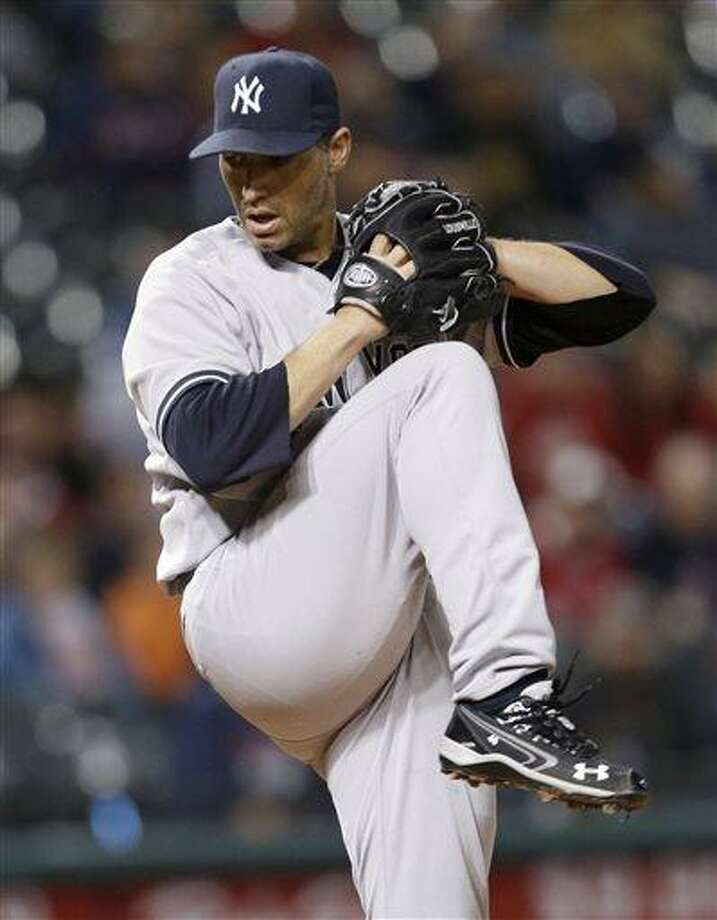 New York Yankees starting pitcher Andy Pettitte winds up in the seventh inning of a baseball game against the Cleveland Indians, Tuesday, April 9, 2013, in Cleveland. New York won 14-1. (AP Photo/Tony Dejak) Photo: ASSOCIATED PRESS / AP2013