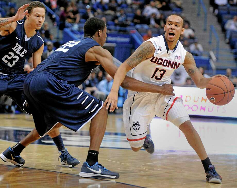 UConn's Shabazz Napier drives past Yale's Justin Sears during the second half of Monday's game in Hartford. Photo: Fred Beckham — The Associated Press  / FR153656 AP