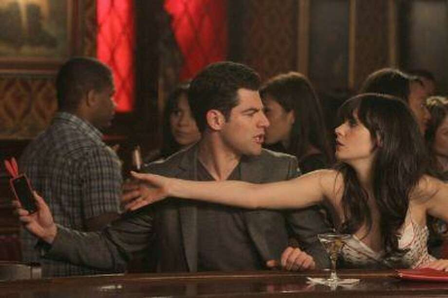 """NEW GIRL: Schmidt (Max Greenfield, L) tries to prevent Jess (Zooey Deschanel, R) from calling an old boyfriend in the """"Backslide"""" episode of NEW GIRL airing Tuesday, May 1 (9:00-9:31 PM ET/PT) on FOX. &Copy;2012 Fox Broadcasting Co. Cr: Patrick McElhenney/FOX Photo: Fox / Fox"""