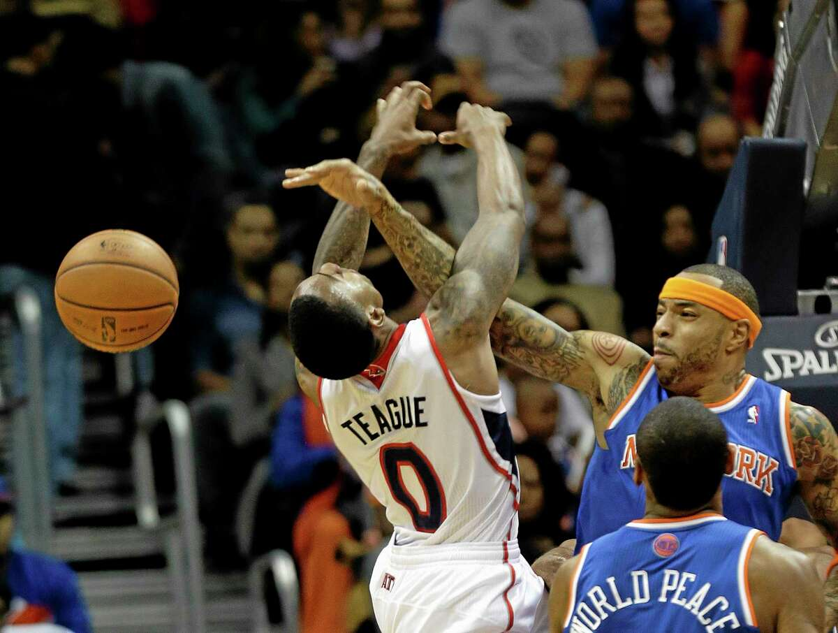 Hawks guard Jeff Teague (0) has his shot blocked by New York Knicks forward Kenyon Martin during the second half of Wednesday's game in Atlanta. The Knicks won 95-91.
