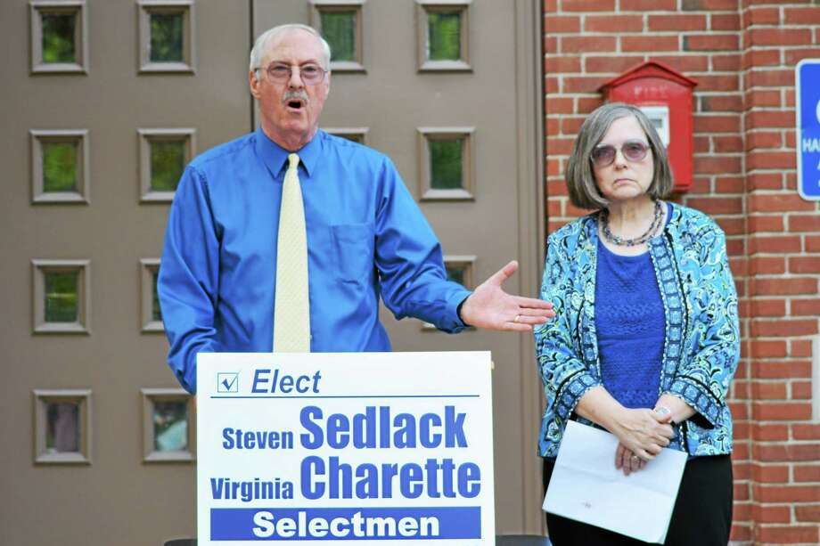 Ryan Flynn - Register Citizen Steve Sedlack and Virginia Charette speak to a crowd of supporters in front of Town Hall Monday evening. Photo: Journal Register Co.