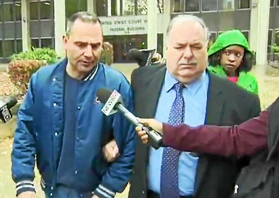 Paul Perrotti, left, walks out of federal court Thursday in Bridgeporti whit his attorney, Martin Minnella. Photo: WTNH News 8 Photo