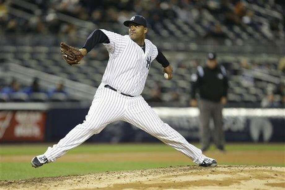 New York Yankees starting pitcher CC Sabathia throws to the Baltimore Orioles during the seventh inning of a baseball game at Yankee Stadium in New York, Friday, April 12, 2013. The Yankees won 5-2. (AP Photo/Julio Cortez) Photo: ASSOCIATED PRESS / AP2013