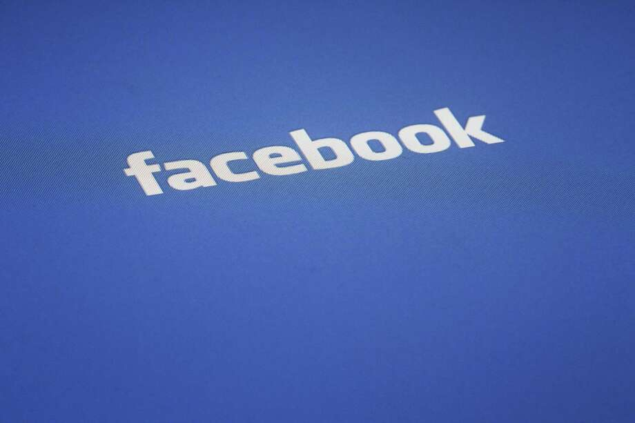 FILE - A Facebook log is displayed on the screen of an iPad, in this Wednesday, May 16, 2012 file photo taken in New York. Photo:  (AP Photo/James H. Collins) / AP