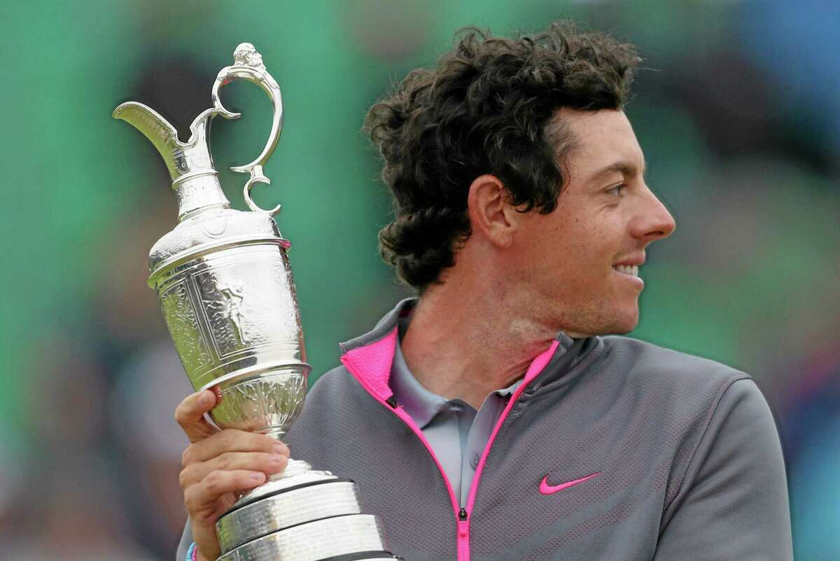 Rory McIlroy holds the Claret Jug after winning the British Open Sunday at the Royal Liverpool golf club in Hoylake, England.