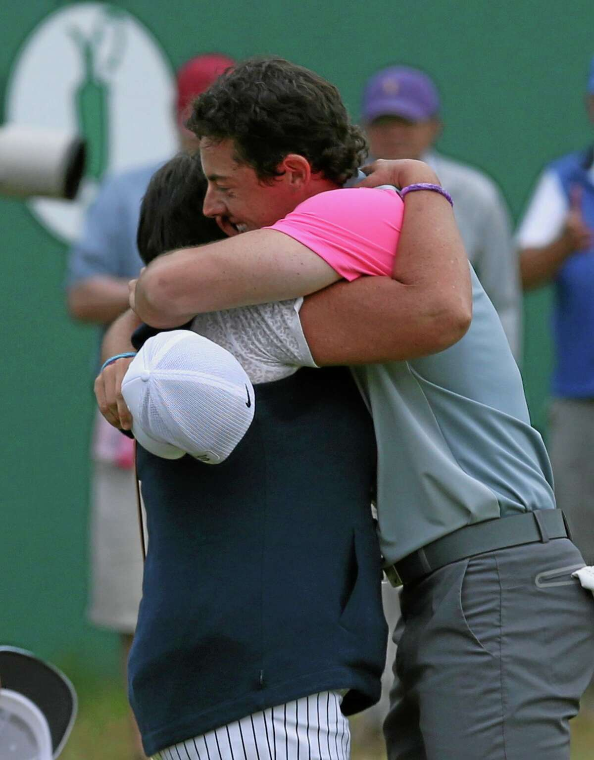 Rory McIlroy hugs his mother Rosie after winning the British Open Sunday.