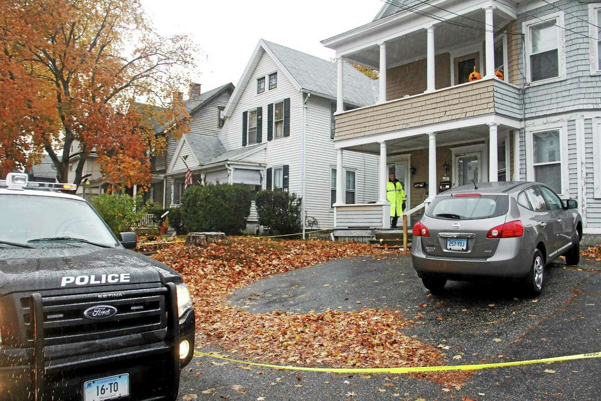 Police tape surrounds a mulit-family home at 34 Forest St. while officers investigate an untimely death Thursday in Torrington.