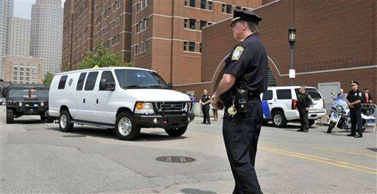 A U.S. Marshal's van, believed to be carrying Boston Marathon bombing suspect Dzhokhar Tsarnaev, arrives at the federal courthouse for his arraignment Wednesday, July 10, 2013, in Boston. The April 15 attack killed three and wounded more than 260. The 19-year-old Tsarnaev has been charged with using a weapon of mass destruction, and could face the death penalty. (AP Photo/Josh Reynolds)