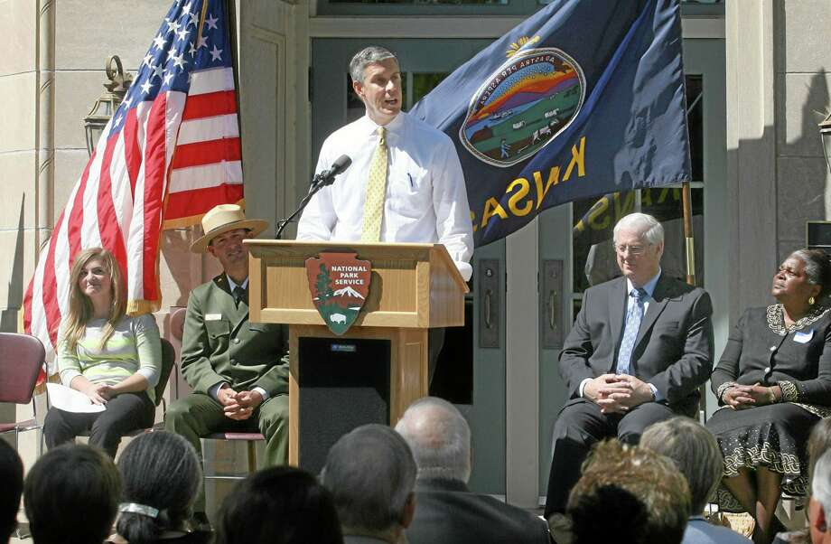 U.S. Secretary of Education Arne Duncan stands outside Monroe School in Topeka, Kan., in this 2012 file photo. Photo: AP Photo  / The Topeka Capital Journal