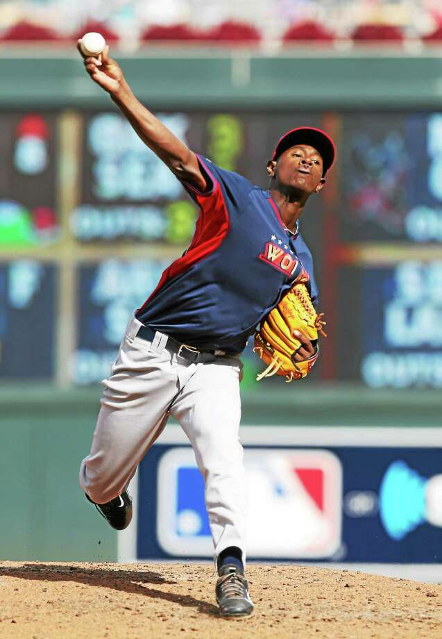 Yankees minor leaguer Luis Severino throws a pitch during the All-Star Futures Game last Sunday in Minneapolis. Photo: Jim Mone — The Associated Press  / AP
