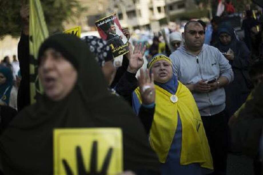 Egyptian women chant slogans Nov. 1 during a protest by supporters of ousted President Mohammed Morsi in Nasr City in Cairo, Egypt. Photo: AP / AP