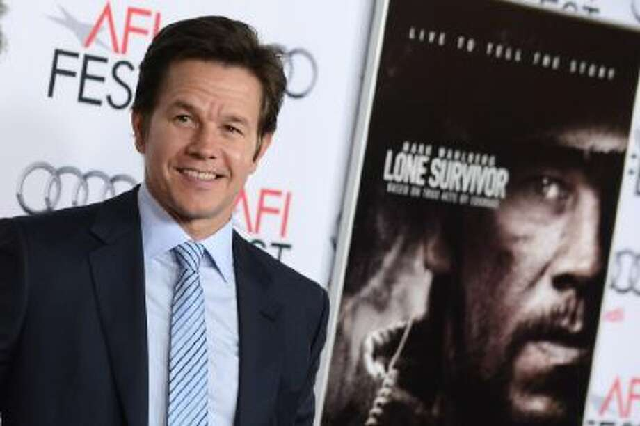 """Mark Wahlberg arrives at the 2013 AFI FEST premiere of """"Lone Survivor"""" at the TCL Chinese Theatre on Tuesday, Nov. 12, 2013 in Los Angeles."""