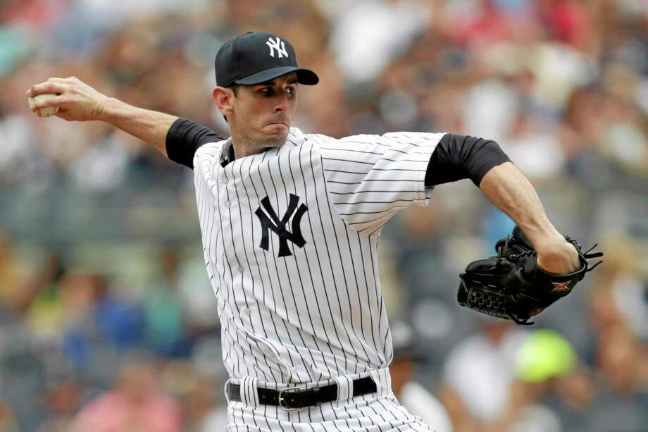 New York Yankees starter Brandon McCarthy got his first win with the team on Saturday against the Reds. Photo: Julio Cortez — The Associated Press  / AP