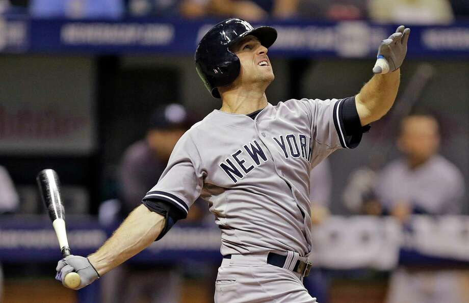 New York Yankees left fielder Brett Gardner follows the flight of his sacrifice fly during a Sept. 17 game against the Tampa Bay Rays in St. Petersburg, Fla. Photo: Chris O'Meara — The Associated Press File Photo  / AP