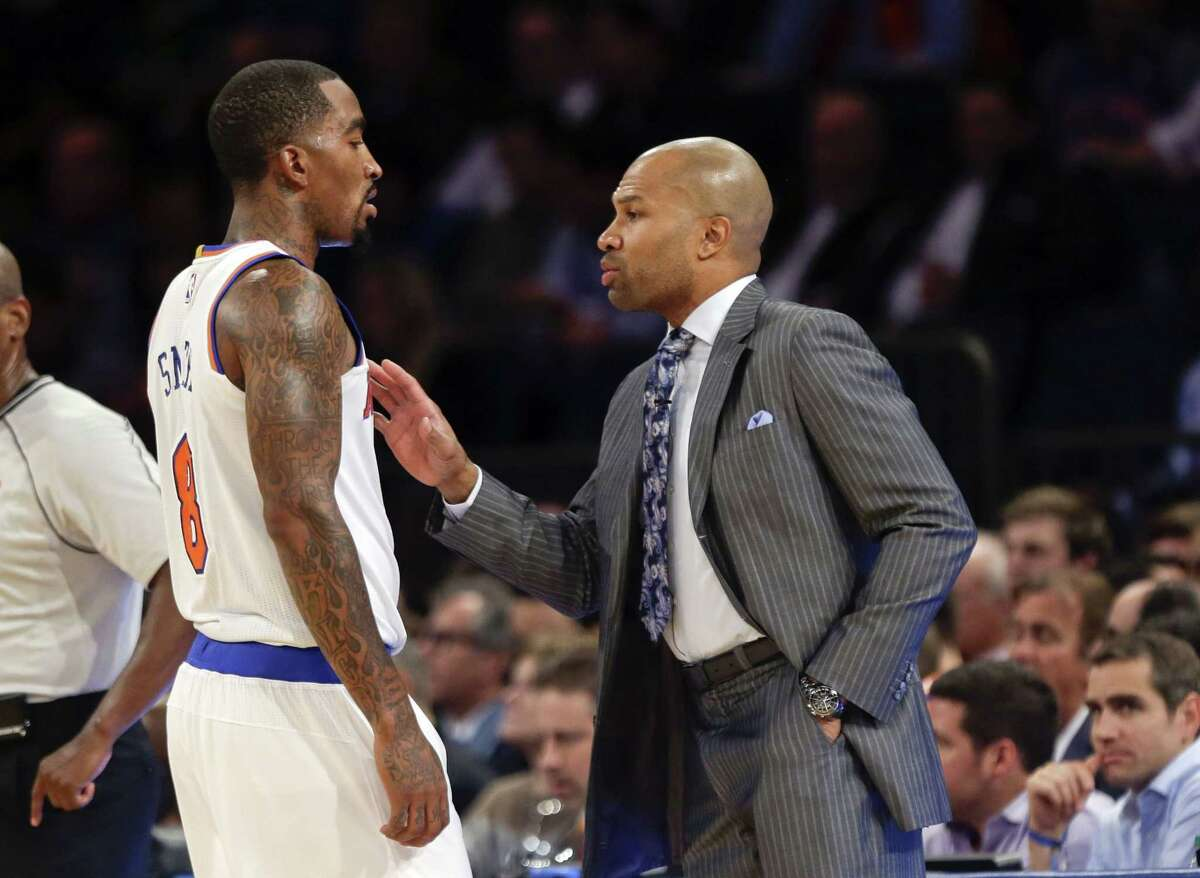 Knicks head coach Derek Fisher talks to J.R. Smith during an Oct. 29 game against the Chicago Bulls in New York.