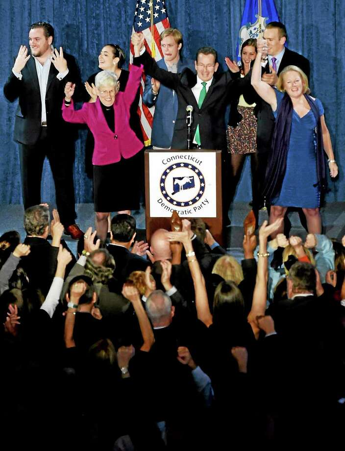 Incumbent Connecticut Gov. Malloy and Lt. Gov. Nancy Wyman,left, and Malloy's wife Cathy right,  give a post-midnight speech to supporters claiming victory on election night at The Society Room in Hartford, Connecticut during a close race against  Republican challenger Tom Foley Tuesday, November 4, 2014. Photo: (Photo By Peter Hvizdak - New Haven Register) / ©2014 Peter Hvizdak