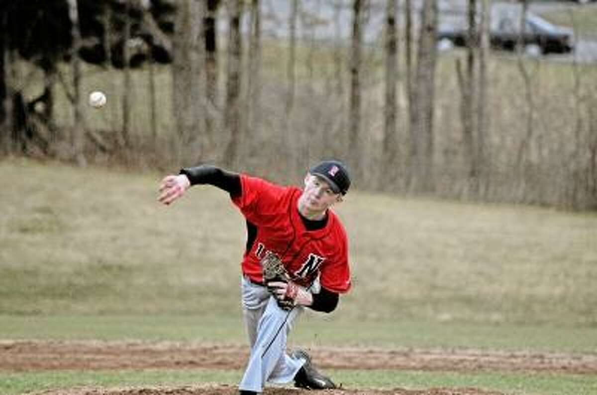 Sean Meenaghan/Register Citizen Northwestern starting pitcher Jimi Phillips prepare to throw a pitch during the Highlanders' game against Litchfield.
