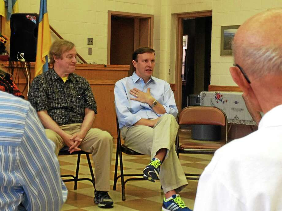 U.S. Sen. Chris Murphy speaks with members of Connecticut's Ukrainian community Saturday about the ongoing crisis in Ukraine in the aftermath of Thursday's downing of Malaysian Air flight MH17. Photo: Kristin Stoller — New Haven Register