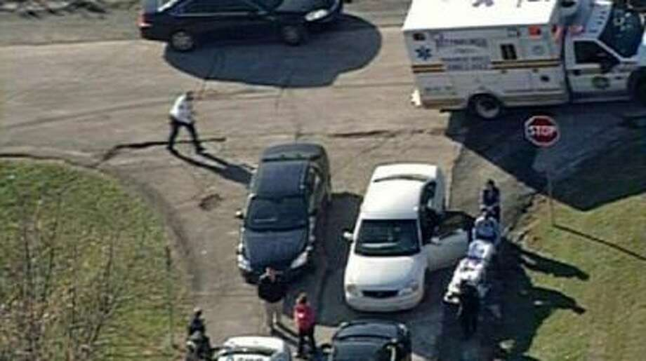 In this image provided by KDKA- TV emergency personal respond to a shooting at the scene near Brashear High School, Monday, in Pittsburgh.
