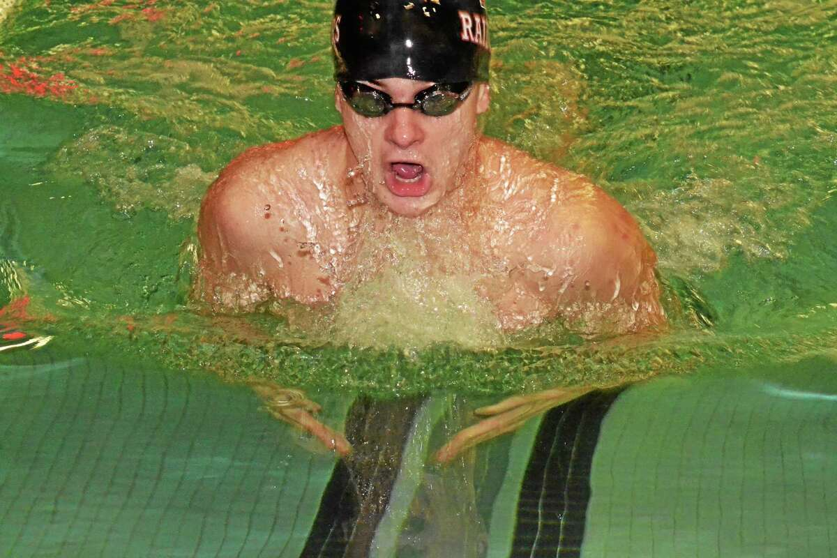 Torrington's Griffin Pelkey swims during the 100 breaststroke. Pelkey won the race clinching the meet for the Red Raiders.