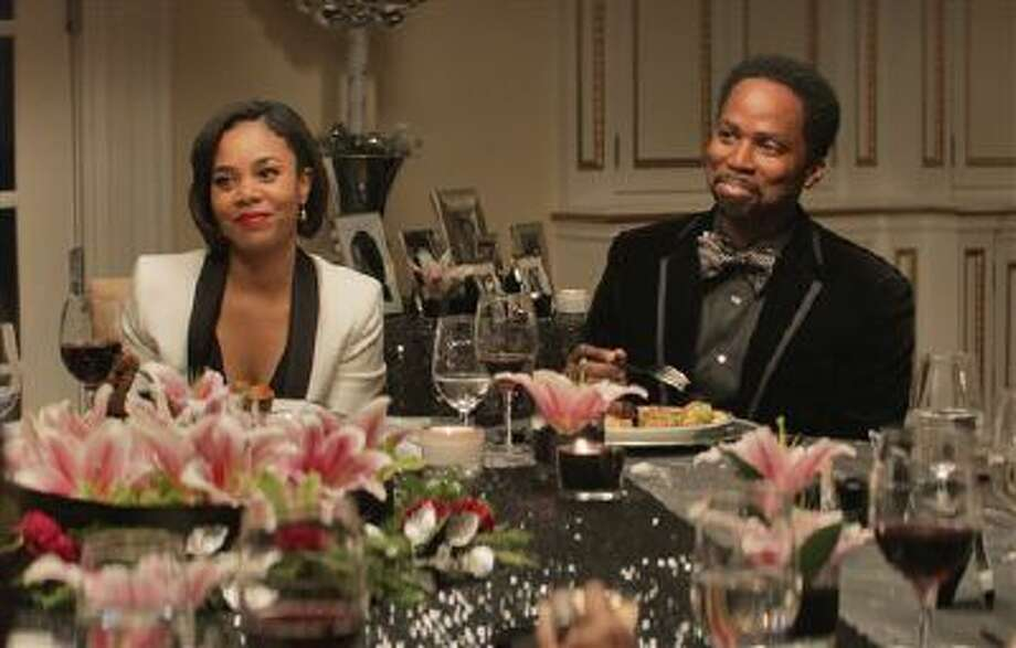 "This image released by Universal Pictures shows Regina Hall, left, Harold Perrineau in a scene from ""The Best Man Holiday."" Photo: AP / Universal Pictures"