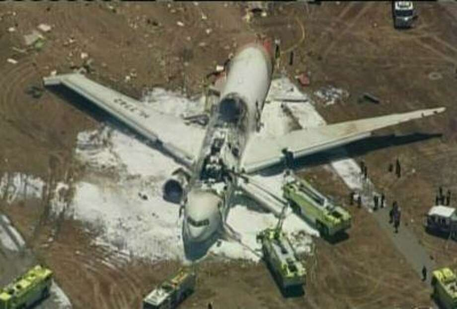 An Asiana Airlines Boeing 777 is pictured after it crashed while landing in this KTVU image at San Francisco International Airport in California, July 6, 2013. Photo: REUTERS / X80001