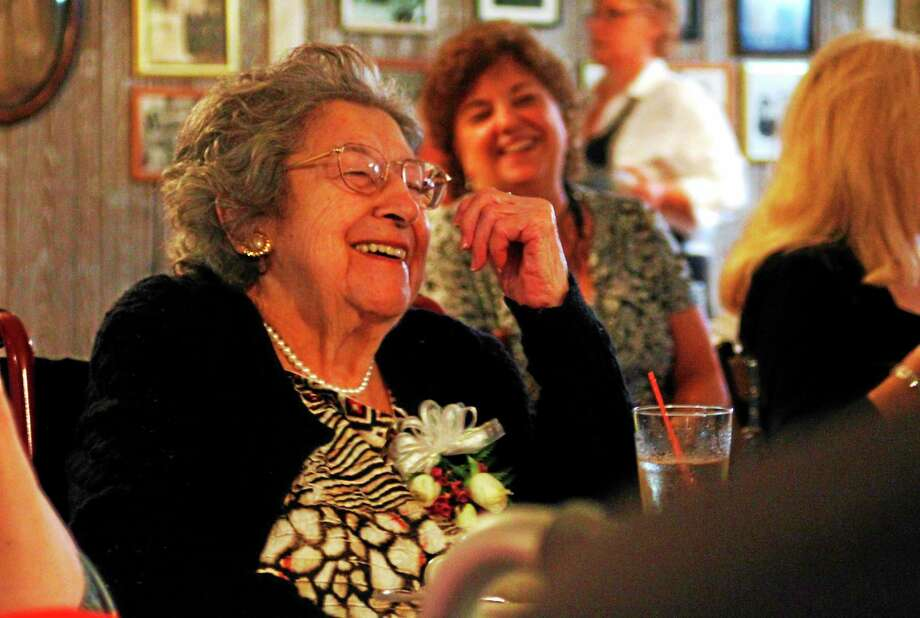 Esteban L. Hernandez-Register Citizen. Mary Tocci laughs after her granddaughter cracks a joke during Tocci's 100th birthday celebration on Saturday, July 19, at Marino's in Torrington. Photo: Journal Register Co.