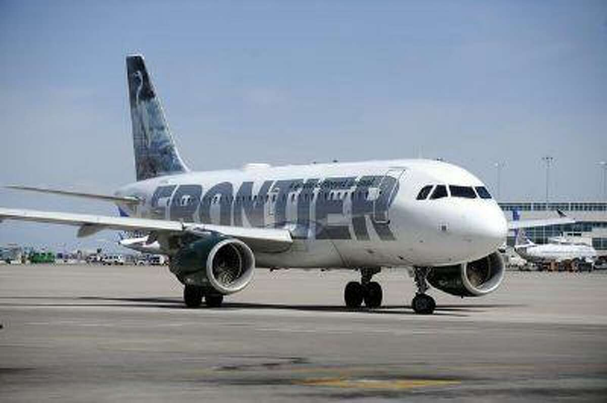 A Frontier airplane taxis to head out of Denver International Airport. (Andy Cross, Denver Post file)