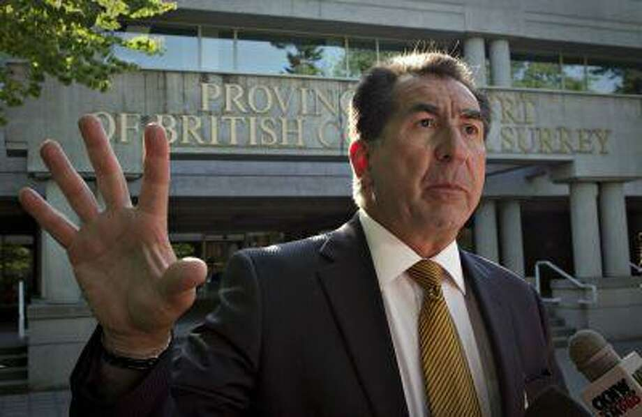 Tom Morino, the lawyer for bomb plot suspects John Nuttall and Amanda Korody, talks with media outside the provincial court in Surrey, British Columbia July 9, 2013. Photo: REUTERS / X00056