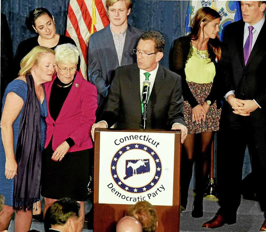 Incumbent Connecticut Gov. Malloy with Lt. Gov. Nancy Wyman, and Malloy's wife Cathy, far left, leaning on Wyman, gives a post-midnight speech to supporters claiming victory on election night at The Society Room in Hartford, Connecticut during a close race against Republican challenger Tom Foley Tuesday, November 4, 2014. Photo: (Photo By Peter Hvizdak - New Haven Register)  / ©2014 Peter Hvizdak