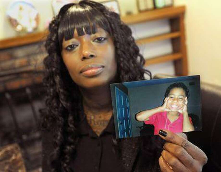 Michele Smith holds a photograph of her son, Mateo Maldonado, at her home in Antioch on April 5, 2013. Smith's son, Mateo Maldonado, 6, was allegedly abused at the hands of his special education teacher. (Dan Honda/Contra Costa Times) Photo: Bay Area News Group / Bay Area News Group