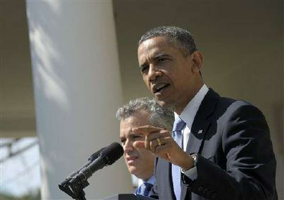 President Barack Obama, accompanied by acting Budget Director Jeffrey Zients, speaks in the Rose Garden of the White House in Washington, Wednesday April 10, 2013, to discuss his proposes fiscal 2014 federal budget. (AP Photo/Susan Walsh) Photo: ASSOCIATED PRESS / AP2013