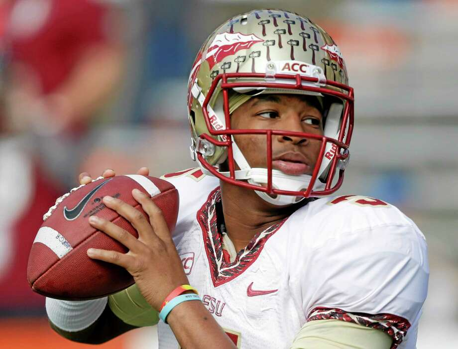 FILE - In this Nov. 30, 2013, file photo, Florida State quarterback Jameis Winston warms up before an NCAA college football game against Florida in Gainesville, Fla. The prosecutor overseeing the investigation of sexual assault allegations against Winston says it is completed. State Attorney Willie Meggs has scheduled a news conference at 2 p.m. Thursday, Dec. 5, 2013, in his office to announce his findings. (AP Photo/John Raoux, File) Photo: AP / AP
