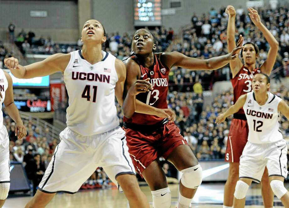UConn's Kiah Stokes (41) and Stanford's Chiney Ogwumike (13) battle for a rebound as Stanford's Tess Picknell shoots and UConn's Saniya Chong defends during the first half of the top-ranked Huskies' 76-57 win over No. 3 Stanford on Monday night in Storrs. Photo: Jessica Hill — The Associated Press  / FR125654 AP