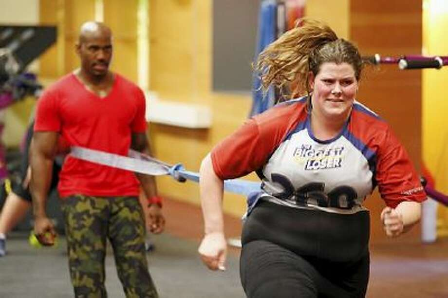 """Rachel Frederickson works with trainer Dolvett Quince in an early episode of """"The Biggest Loser"""" this TV season. Frederickson won the competition, losing nearly 60 percent of her body weight."""