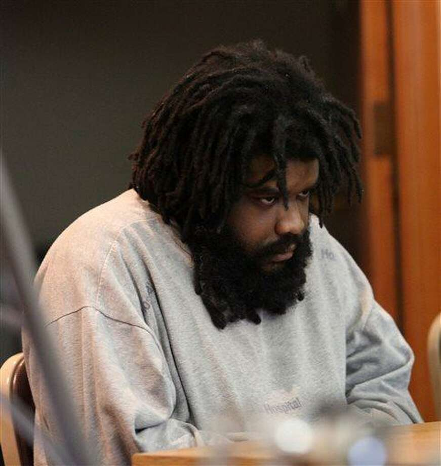 Tyree Smith sits during the first day of his trial before a three judge panel in Bridgeport, Conn., July 1, 2013. Smith is accused of killing and then eating parts of a homeless man in Connecticut.    (AP Photo/The Connecticut Post, B.K. Angeletti) MANDATORY CREDIT Photo: AP / The Connecticut Post