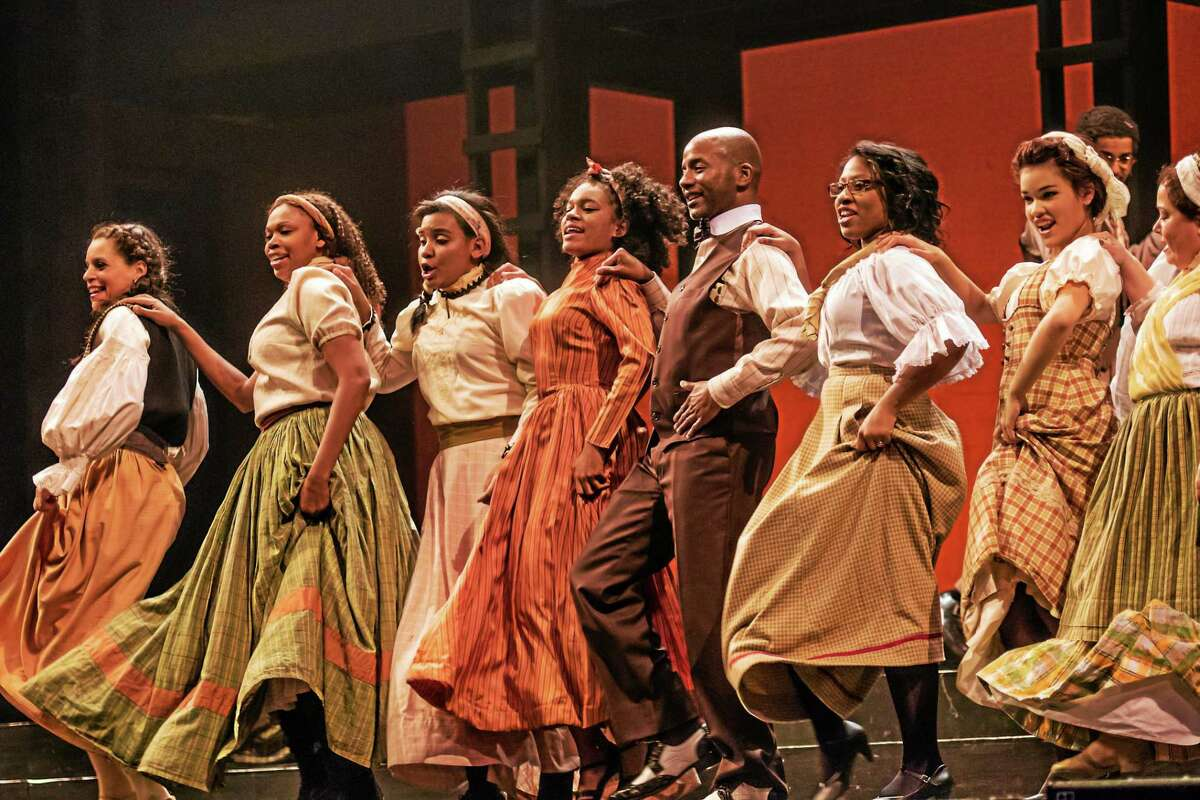 """Photos by Luke Haughwot The cast of """"Ragtime"""" performs a scene from the musical, which continues until Sunday at the Warner Theatre."""