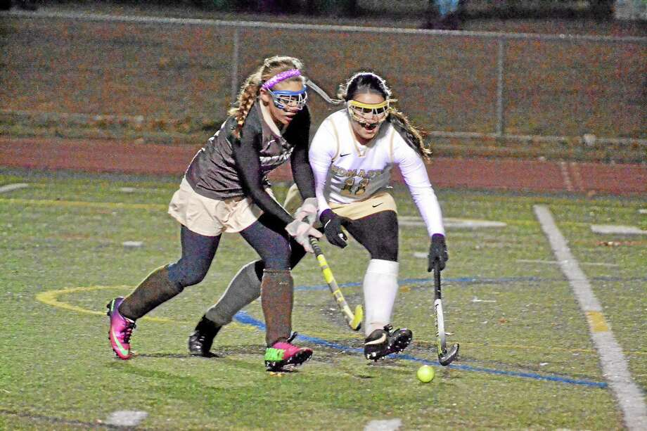 Thomaston's Erin O'Neill pokes the ball away from Stonington's Meg O'Lari during the Golden Bears 4-0 loss in the Class S State Tournament. Photo: Pete Paguaga — Register Citizen