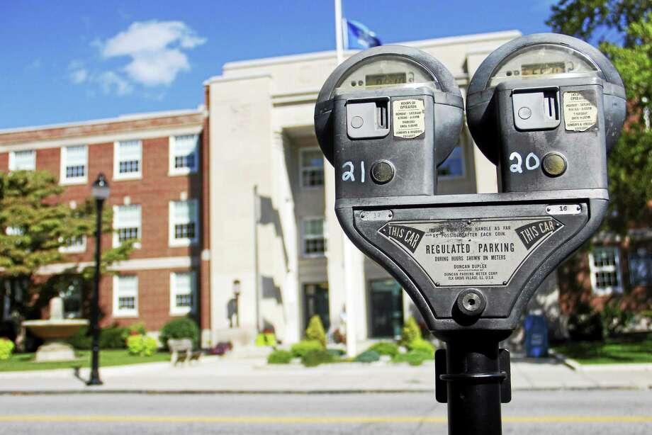 A parking meter is seen in front of Torrington City Hall in September. Photo: Esteban L. Hernandez — The Register Citizen