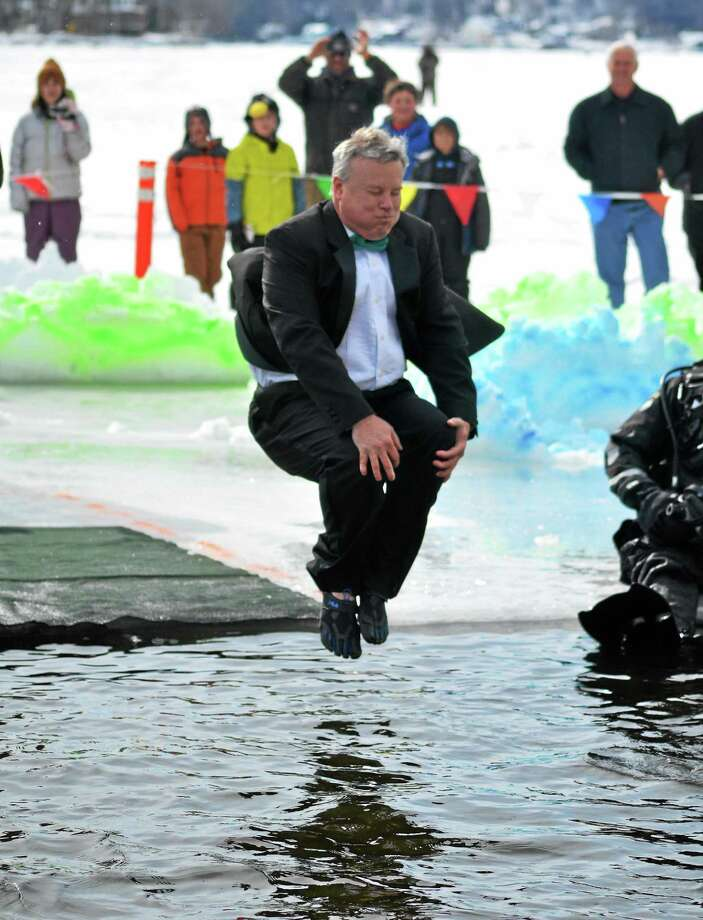Winsted Town Manager Dale Martin dives in to Highland Lake on Saturday as part of the Penguin Plunge, a fundraiser held annually in Winsted for Special Olympics. John Berry - The Register Citizen Photo: Journal Register Co.