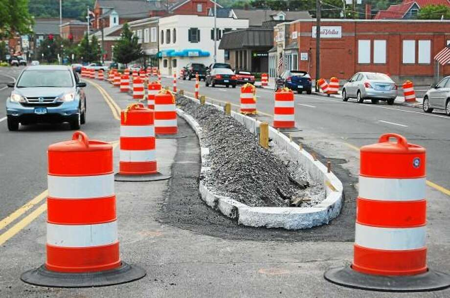 The phase two installation of medians is under way on Main Street in Winsted. (Mercy Quaye -- Register Citizen)