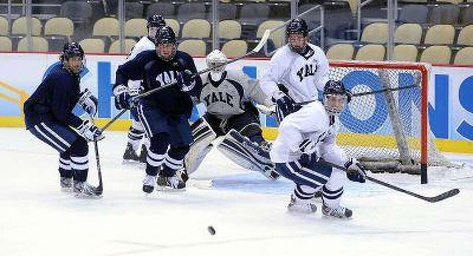 "Pittsburg, PA-- Yale during a practice at the Consol Energy Center in Pittsburg, PA as they prepare for the Frozen Four finals. Photo-Peter Casolino/Register  <a href=""mailto:pcasolino@newhavenregister.com"">pcasolino@newhavenregister.com</a>"