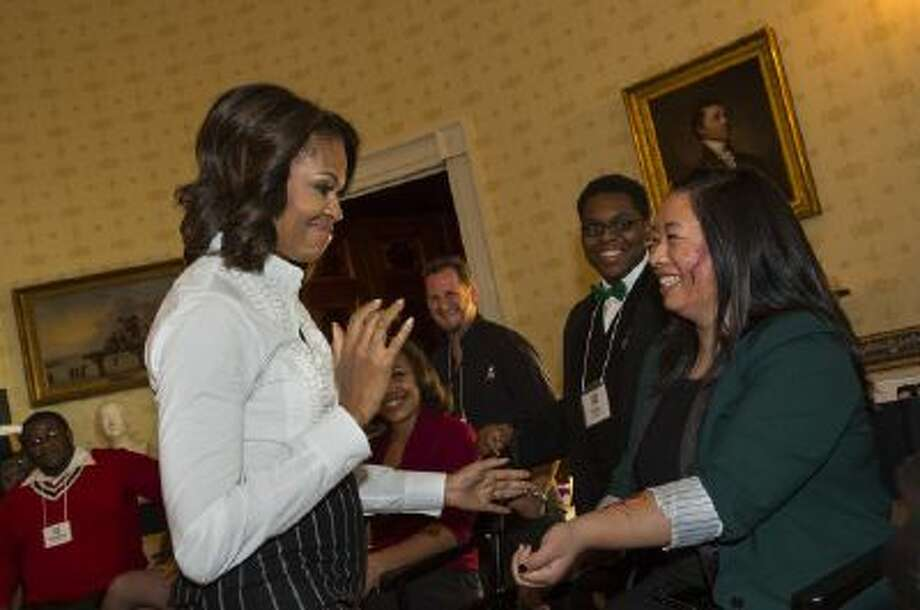 "First Lady Michelle Obama admires the macabre work of make up artists for an upcoming festival at The White House, one of many events she holds at ""the people's house."""