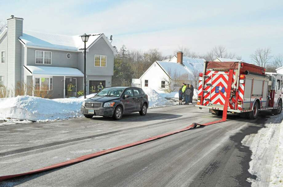 Firefighters respond to a dryer fire on Santa Maria Dr. in Torrington Saturday. First responders on the scene said that the fire was contained to the appliance, but there was a lot of smoke filling the house. John Berry - The Register Citizen Photo: Journal Register Co.