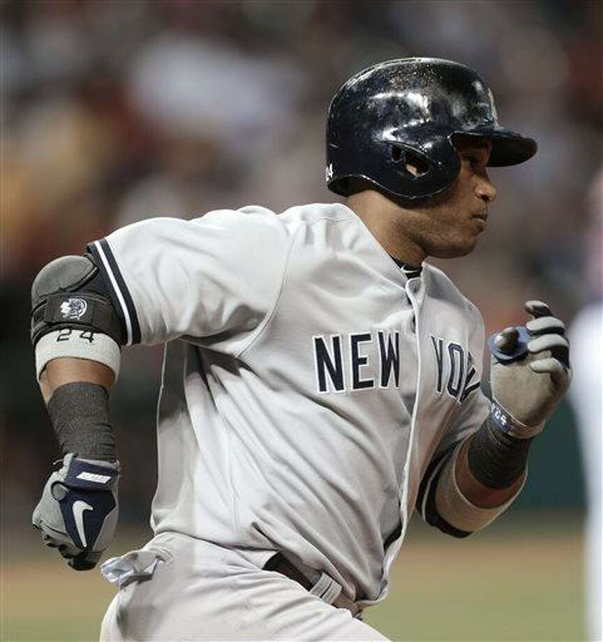 New York Yankees' Robinson Cano runs the bases after hitting a two-run home run off Cleveland Indians starting pitcher Carlos Carrasco in the fourth inning of a baseball game, Tuesday, April 9, 2013, in Cleveland. (AP Photo/Tony Dejak) Photo: AP / AP