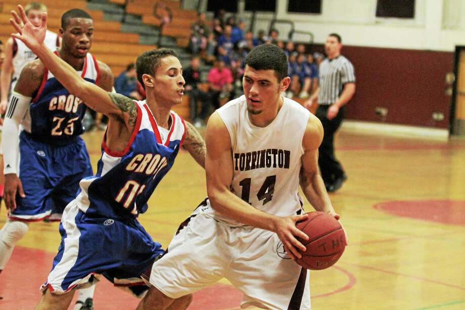 Torrington's Desmond Langs looks to make a pass. Langs finished with a team high 17 points. Photo: Marianne Killackey — Special To The Register Citizen  / 2013