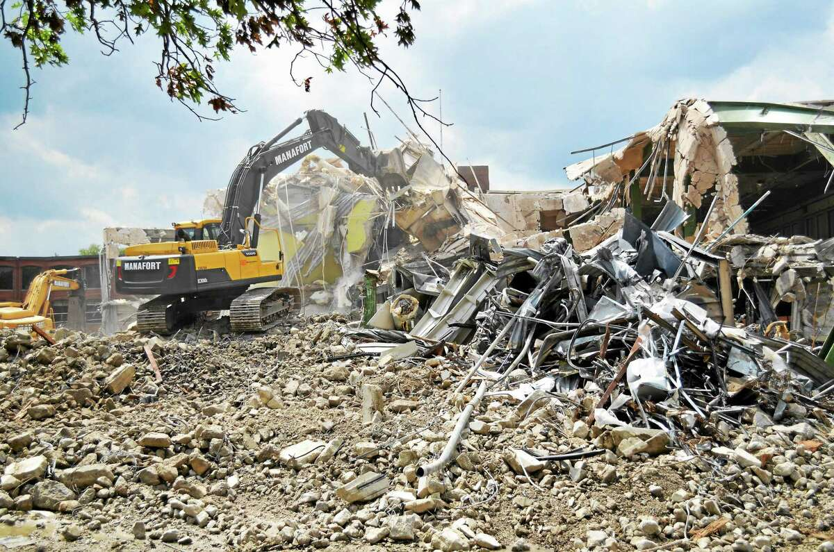 Demolition crews tearing down the 40,300-square-foot building at 50 Field St. once owned by the Torrington Company, clearing space for parking for the upcoming Litchfield County courthouse complex.