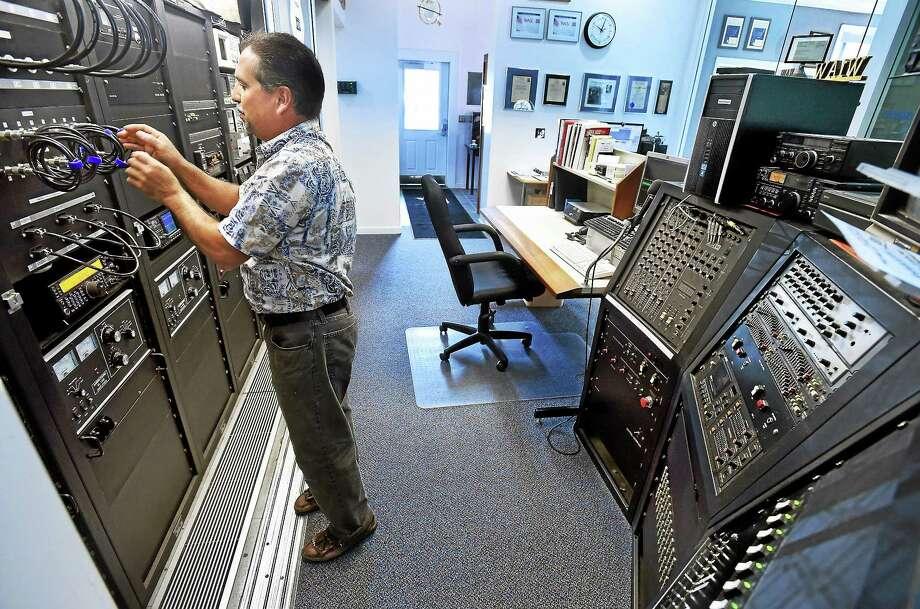 W1AW station manager Joe Carcia with the main operating console in Newington. Photo: Mara Lavitt — New Haven Register   / Mara Lavitt