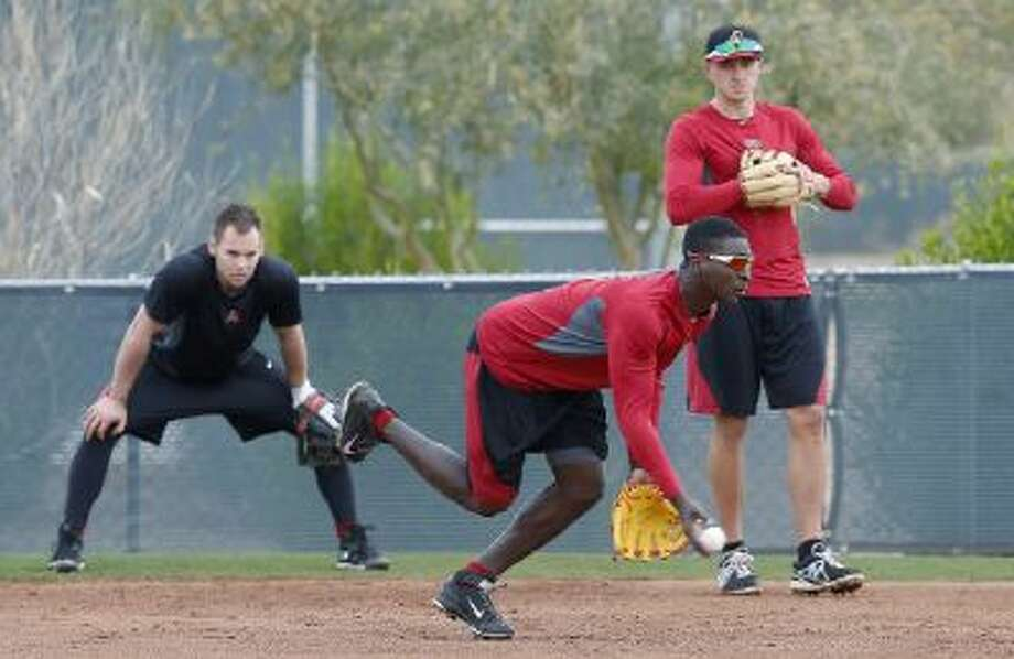 Diamondbacks infielders work out at an informal practice in Scottsdale, Ariz. Pitchers and catchers have reported to Arizona camp.